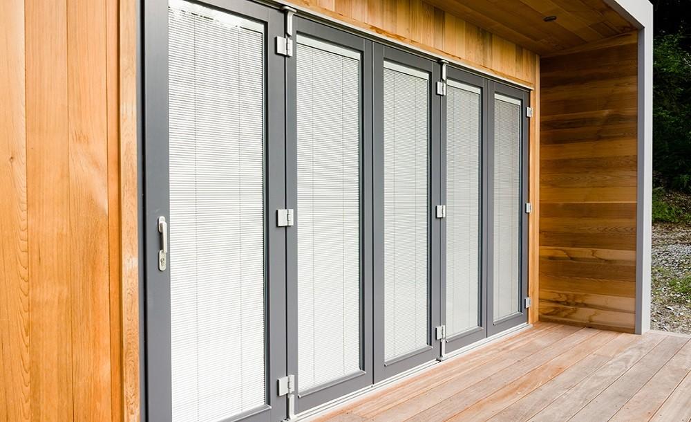 Maintenance-free, dust-free, allergy-free integral blinds for garden studios
