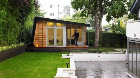A bespoke garden retreat nestled amongst the trees completed of sedum roof and cedar tiles