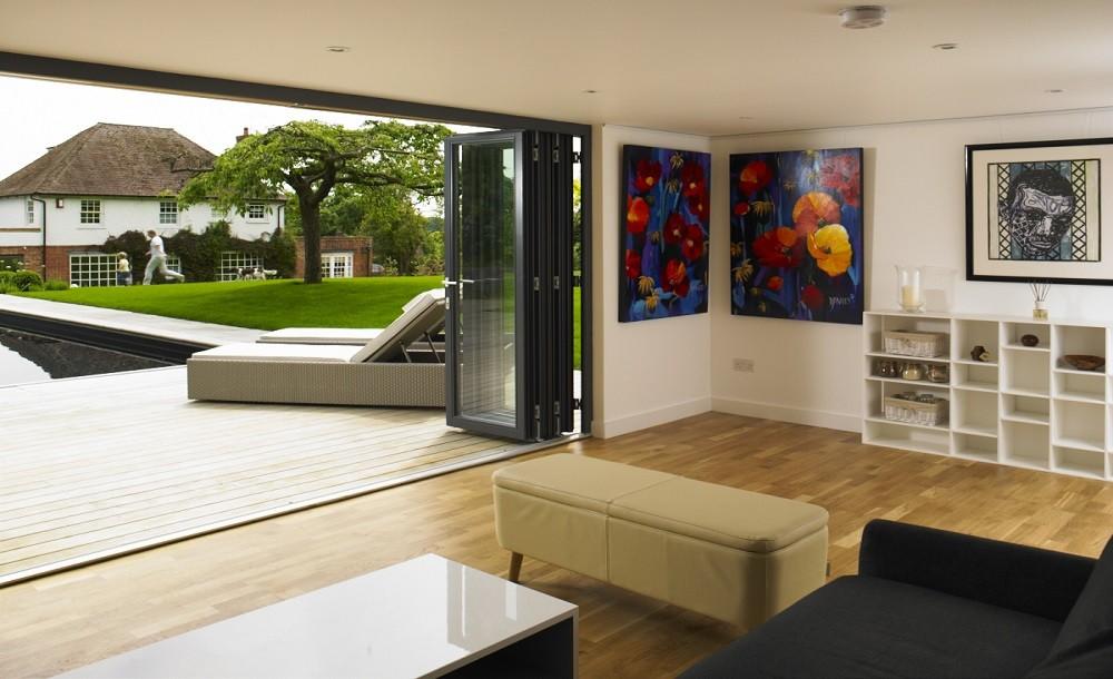 Bifolding double glazed doors for a garden studio by Rooms Outdoor