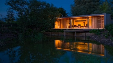 Weekend retreat on the Norfolk Broads, combining contemporary design in a rural setting overlooking a lake.