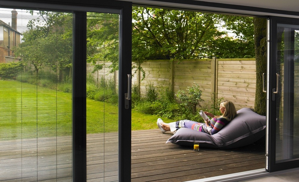 Sliding door with integral blinds for a garden studio by Rooms Outdoor
