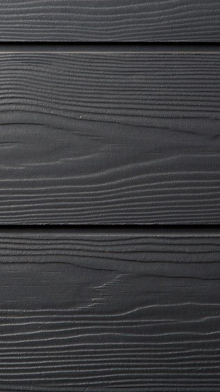 Composite cladding with a wooden effect texture for garden studios