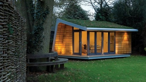 A bespoke garden retreat with ceadr tiles and green roof