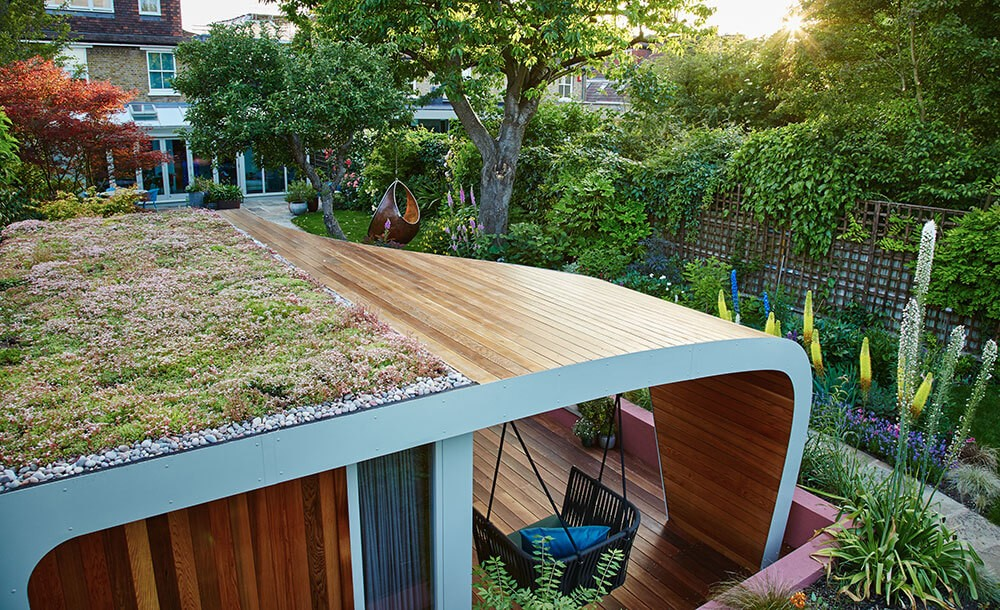 Bespoke outdoor office with sedum roof in Chiswick